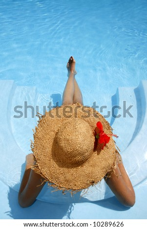 Woman lying in blue pool - stock photo