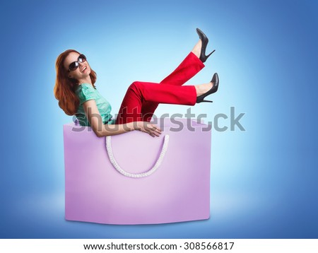 Woman lying in the bag - stock photo