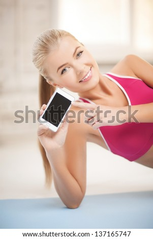 woman lying on the floor and sowing smartphone - stock photo