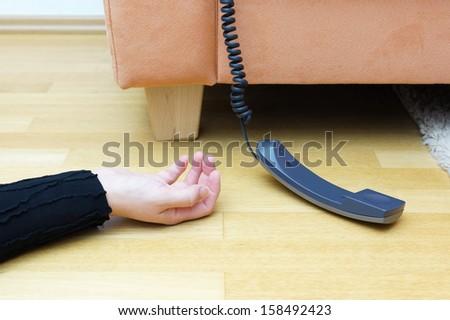 woman lying on the floor unconscious - stock photo