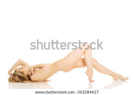 Woman lying with bended knee - stock photo