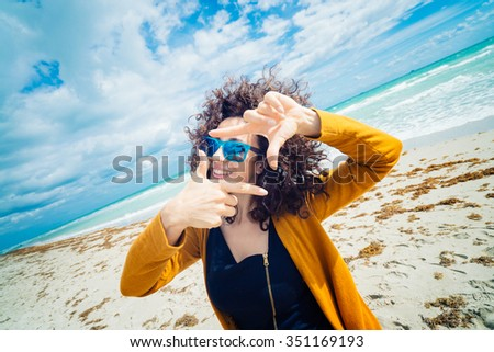 Woman make a frame whit hands - stock photo