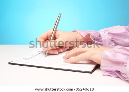 Woman make plans - hand with pen take a note in calendar. - stock photo