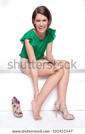 Woman makes a break because her shoes do hurt - stock photo
