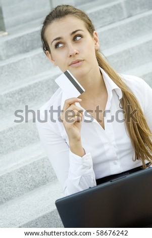 Woman makes an online purchase or does her business or personal banking online - stock photo