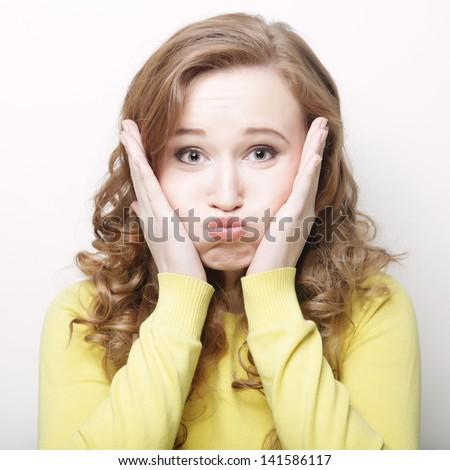 Woman making a funny face.Studio shot. - stock photo