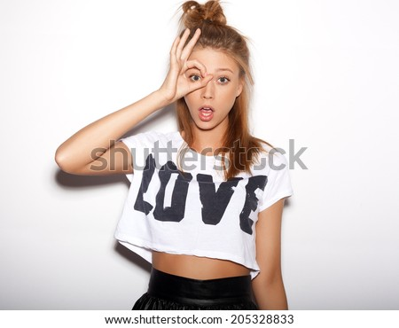 Woman making a pair of glasses with one hand. White background, not isolated - stock photo