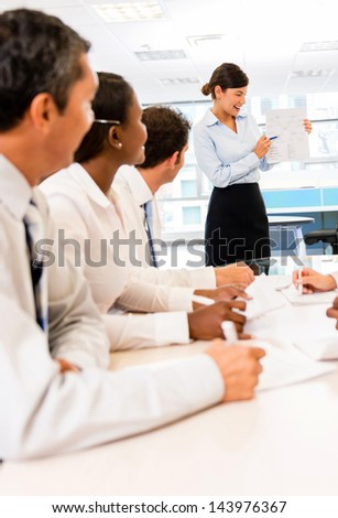 Woman making a presentation in a successful business meeting - stock photo