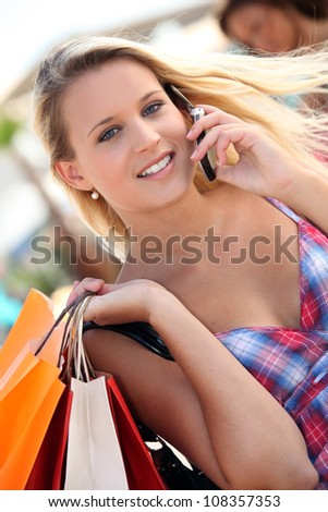 Woman making all during city shopping trip - stock photo