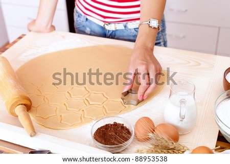 Woman making cake in the kitchen - stock photo