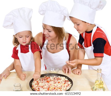 Woman making pizza with her kids at home - isolated - stock photo