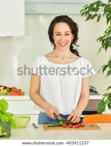 Woman making salad in kitchen. Healthy eating lifestyle concept. Dieting concept. Healthy Food - stock photo
