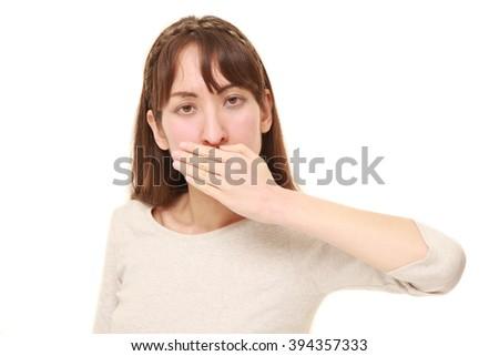 woman making the speak no evil gesture - stock photo