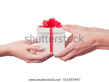 Woman & man hand. Holding a gift. With clipping path included. - stock photo