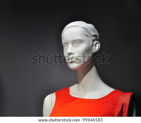 Woman mannequin in red dress, fashion shop - stock photo