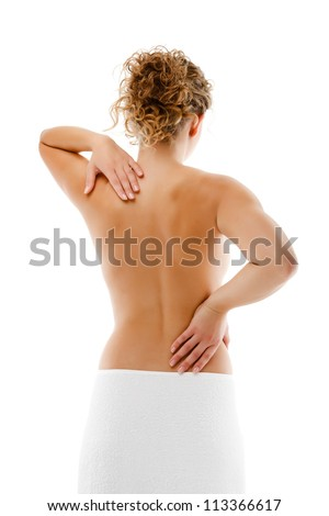 Woman massaging pain back isolated on white background - stock photo
