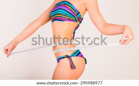 Woman measuring her body  - stock photo