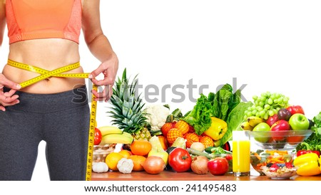 Woman measuring her body. Diet and healthy nutrition. - stock photo