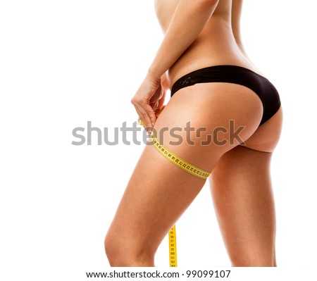 Woman measuring her body. Isolated over white. - stock photo