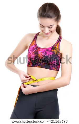 Woman measuring her body - weight loss concepts - stock photo