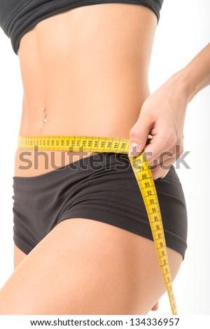Woman measuring her thin waist - stock photo