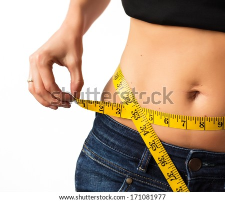 Woman measuring her waistline - stock photo