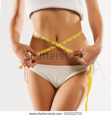 Woman measuring her waistline . Perfect Slim Body - stock photo