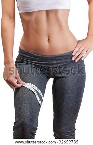 woman measuring thigh - stock photo