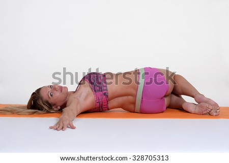 Woman meditating and doing yoga against isolated  white background. - stock photo