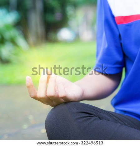 Woman meditation In the natural park morning sun - stock photo
