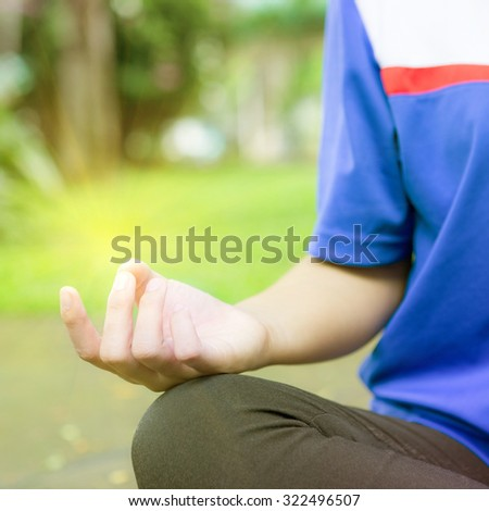 Woman meditation In the natural park with natural light. - stock photo