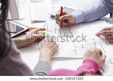 Woman meeting architect for house construction - stock photo