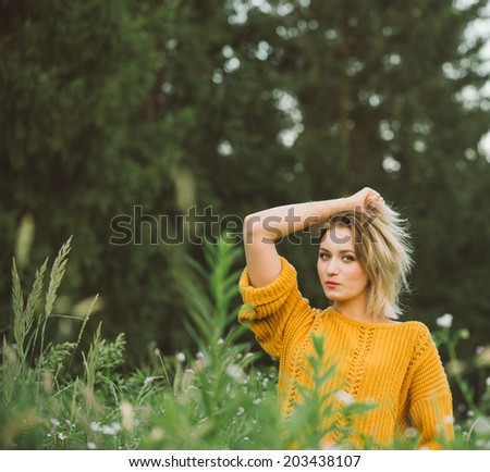 woman model outdoors in summer enjoying the rays of the setting sun. Retro style, fashion. - stock photo