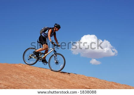Woman mountain biking in Moab - stock photo