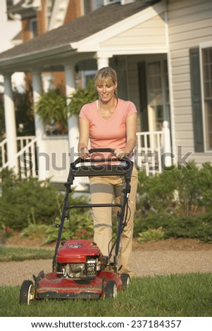 Woman Moving her Lawn - stock photo