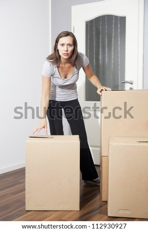 Woman moving house - stock photo