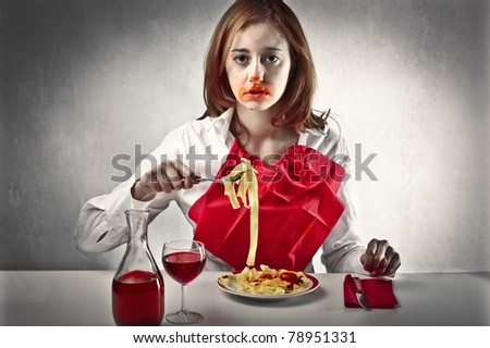 Woman mucking up her face while eating spaghetti - stock photo