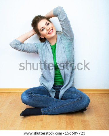 Woman natural portrait,  yoga exercises at home. White background. wooden floor. - stock photo