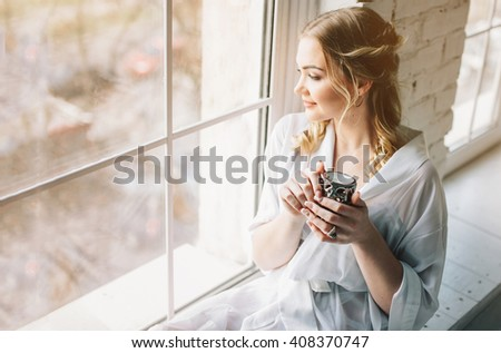 woman near window.Dream and relax - stock photo