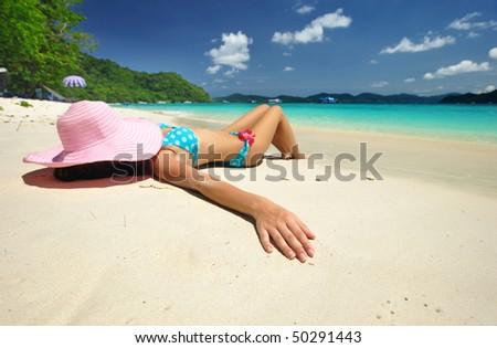 Woman on a beautiful beach - stock photo