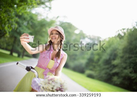 Woman on a bicycle in the park - stock photo