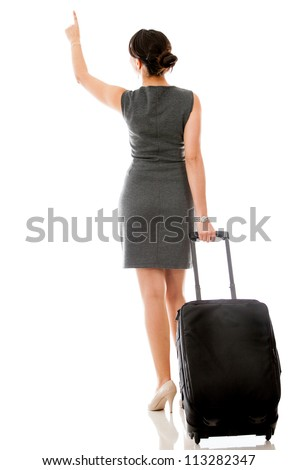 Woman on a business trip pointing with her finger - isolated - stock photo