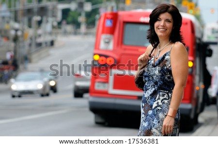 Woman On A City Street With Traffic In The Background - stock photo