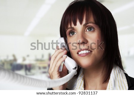 woman on a land line phone talking to someone - stock photo