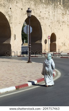 Woman on a street in Fes, Morocco - stock photo