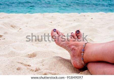 Woman on beach vacation - stock photo