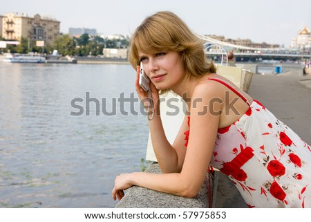 Woman on cellphone.  Young attractive brunette woman using mobile phone Happy girl Laughing - stock photo