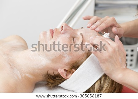 Woman on cosmetics treatment - stock photo