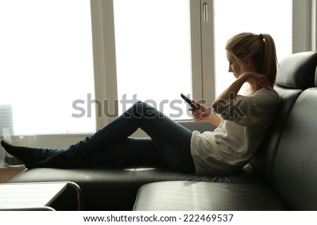 Woman on couch - stock photo