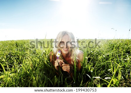 woman on green grass close up - stock photo